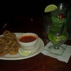 Photo taken at Mojitos Cuban Restaurant by Yoann P. on 3/3/2013