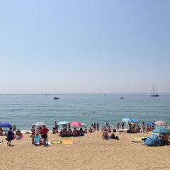 Photo taken at Platja del Pla de Montgat by Muharrem Ş. on 7/14/2013