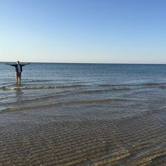 Photo taken at Sea Street Beach by Jillian N. on 9/18/2015