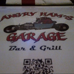 Photo taken at Angry Ham's Octane Bar & Grill by Simon H. on 10/9/2012