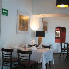 Photo taken at La Taba Restaurante Argentino by Karina R. on 3/27/2013