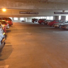 Photo taken at Henderson Parking Garage by Carl J. on 12/13/2015