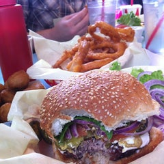 Photo taken at Sylvesters Burgers by Aaron M. on 2/18/2013