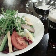 Photo taken at Irish Pub Stasiun 田町店 by Kyoko O. on 11/29/2014
