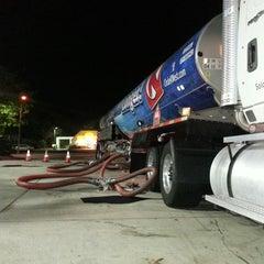 Photo taken at Mobil by Juan H. on 7/25/2014