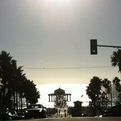 Photo taken at Manhattan Beach by Anderson T. on 10/8/2012