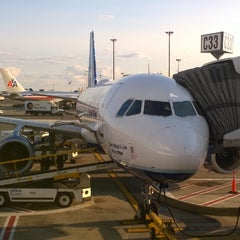 Photo taken at Gate C33 by Dmitry P. on 8/8/2014