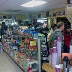 Photo taken at Henry Street Deli Mart by Charlie R. on 9/29/2012