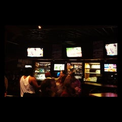 Photo taken at The Draft Bar and Grill by Daniel R. on 12/2/2012