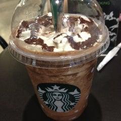 Photo taken at Starbucks by clairinnee on 1/2/2013
