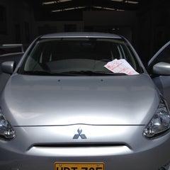 Photo taken at Motorysa Mitsubishi Colombia by Sebastian P. on 3/14/2015