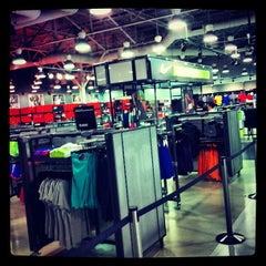 Photo taken at Nike Factory Store by Montse S. on 6/6/2013
