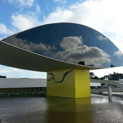 Photo taken at Museu Oscar Niemeyer (MON) by Thiago C. on 6/9/2013