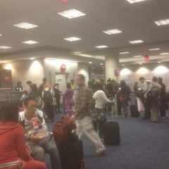 Photo taken at Gate 43 by Luke d. on 12/16/2012
