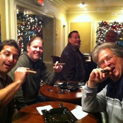 Photo taken at Jamie's Cigar Bar & Restaurant by Doug C. on 12/18/2012