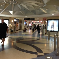 Photo taken at Terminal 4 by Holly C. on 10/28/2012