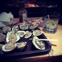 Photo taken at Cooter Brown's Tavern & Oyster Bar by Ashley S. on 11/17/2013