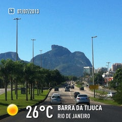 Photo taken at Barra da Tijuca by Leandro S. on 7/7/2013