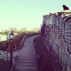 Photo taken at Naksan Park by Yoonski K. on 11/20/2012