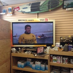 Photo taken at Freeline Design Surf Shop by Tara M. on 5/30/2014