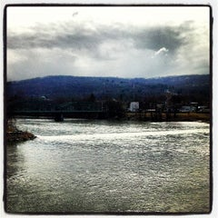 Photo taken at South Washington Street Bridge by Joshua A. on 3/26/2013