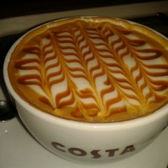Photo taken at Costa Coffee by Petra D. on 12/26/2012