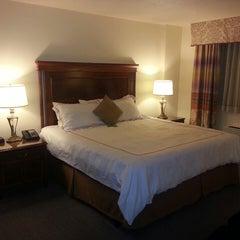 Photo taken at Savoy Suites Hotel by Stéphane K. on 2/26/2013