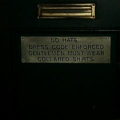 Photo taken at Downing Street Pub & Cigar Bar by Adrian G. on 9/29/2012