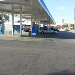 Photo taken at Mobil by Jose G. on 6/19/2013
