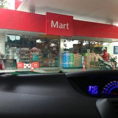 Photo taken at Caltex by Alia A. on 4/18/2013