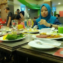 Photo taken at Spinnaker Waterfront Labuan by AinZaLHaKiMi on 7/20/2014