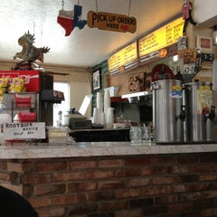 Photo taken at Del's Charcoal Burgers by Tara S. on 1/12/2013