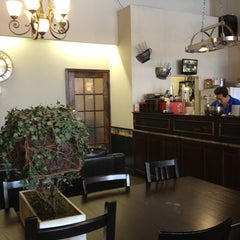 Photo taken at Green Grotto Tea Room 綠的小窩 by Lulu on 1/21/2013