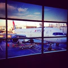 Photo taken at Gate 57 by Aleksander P. on 10/30/2014