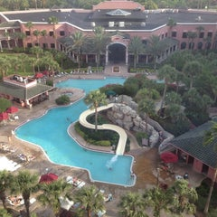 Photo taken at Caribe Royale All-Suite Hotel & Convention Center by Daniel S. on 5/11/2013