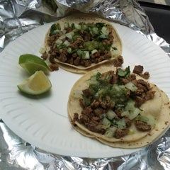 Photo taken at Tacos San Buena by Donnie B. on 2/11/2015