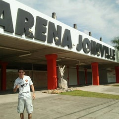 Photo taken at Estádio Arena Joinville by Ronildo A. on 5/12/2013