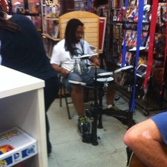 Photo taken at Third Coast Comics by Hannah Belle L. on 8/16/2014