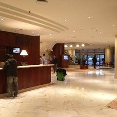 Photo taken at Corinthia Hotel by Sang Pyo on 2/28/2013