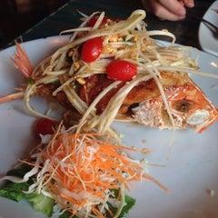 Photo taken at Thai Thani Restaurant by Nikki T. on 8/14/2014