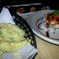 Photo taken at Sushi Ajito by Beth F. on 3/19/2014