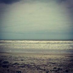 Photo taken at Praia de Itapoá by Leo C. on 10/17/2012