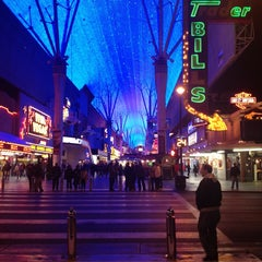 Photo taken at Fremont Street Flightlinez by LaDonna S. on 12/30/2012