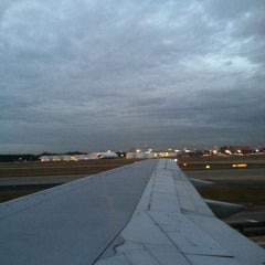 Photo taken at Gate B33 by Michelle K. on 12/4/2012