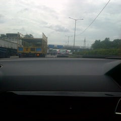 Photo taken at Gerbang Tol Pondok Gede Timur by Idhamshah R. on 3/9/2012