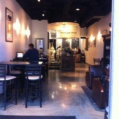 Photo taken at Press Coffee Roasters by Janae J. on 3/17/2011