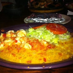 Photo taken at El Jalapeños Authentic Mexican Restaurant by Celeste R. on 12/11/2011