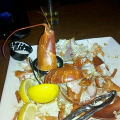 Photo taken at Beach House Grill and Bar by Alex H. on 1/17/2012