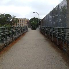 Photo taken at East 8th Street Footbridge by Justin W. on 6/12/2012