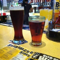 Photo taken at Buffalo Wild Wings Grill & Bar by Kelly R. on 5/12/2012